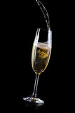 Champagne pouring in crystal glass Royalty Free Stock Photography