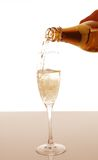 Champagne pouring into elegant glass Stock Image