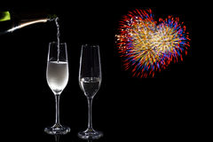 Champagne pouring & firework heart Royalty Free Stock Photos