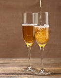 Champagne pouring in glass Royalty Free Stock Photo