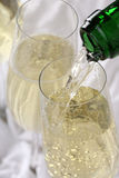 Champagne pouring into a glass on birthday or New Year's Eve Stock Photo