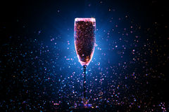 Champagne pouring in glass Royalty Free Stock Photography