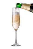 Champagne pouring in a glass Royalty Free Stock Images