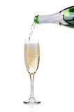 Champagne pouring in a glass. Royalty Free Stock Photography