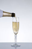 Champagne pouring into a glass Royalty Free Stock Photos
