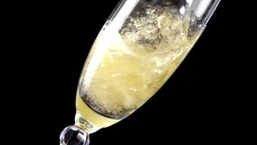 Champagne pouring into glass in slow motion. 200 fps.Shot on Sony NEX Fs700 stock footage