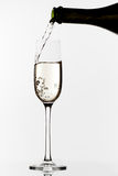 Champagne pouring Stock Images