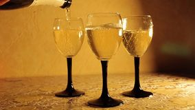 Champagne pouring in glasses. On the table stock video footage