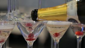 Champagne pouring in two glasses from a bottle. Two Champagne Glass On Defocused stock image