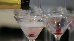 Champagne pouring in two glasses from a bottle. Two Champagne Glass On Defocused stock images