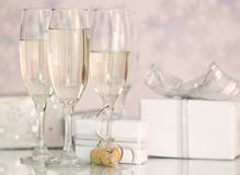 Champagne With Presents Royalty Free Stock Image