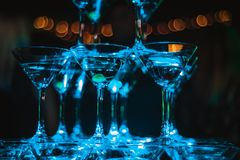 Champagne pyramid in blue club lights. new year celebration concept.  stock images