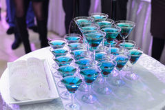 Champagne pyramid on event, cherry in the glass. Dry ice floats Stock Image