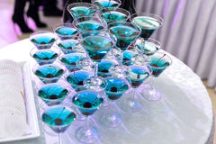 Champagne pyramid on event, cherry in the glass. Dry ice floats Stock Photography