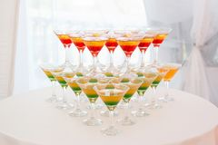 Champagne pyramid with waitress on event, party or wedding banquet reception royalty free stock photo