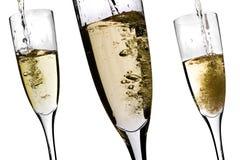 Champagne que está sendo derramado Fotografia de Stock