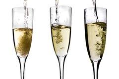 Champagne que está sendo derramado Imagens de Stock Royalty Free