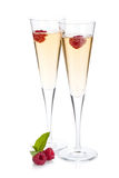 Champagne with raspberry. Isolated on white background Stock Images