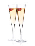 Champagne with raspberry. Isolated on white background Royalty Free Stock Photos