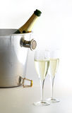 Champagne is ready!. Close up of two champagne flutes and a bottle in the bucket Royalty Free Stock Photo