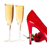 Champagne and red heels Royalty Free Stock Photography