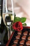 Champagne and red rose Stock Images
