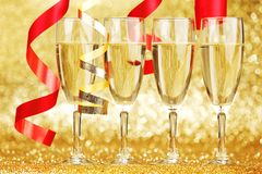 Champagne and ribbons Stock Photography
