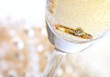 Champagne with ring. Close up Royalty Free Stock Photography