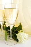 Champagne and rose. Two glasses with champegne and white rose royalty free stock photography