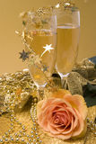 Champagne and rose. Glasses of champagne, golden ribbon and beauty rose Royalty Free Stock Photography