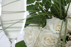 Champagne and roses. Champagne and white roses Stock Photo