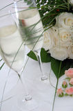 Champagne and roses. Champagne and white roses Royalty Free Stock Photos