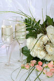 Champagne and roses. Champagne and white roses Royalty Free Stock Photo