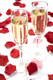Champagne and Roses. Glasses of Champagne and Rose Petals stock images