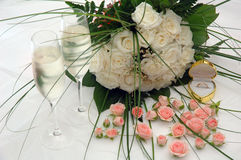 Champagne, roses and ring. Champagne and white roses Stock Photography
