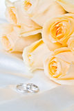 Champagne roses with rings. The champagne roses with pair rings on the cloth Royalty Free Stock Photo