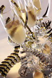 Champagne and serpentines Stock Images