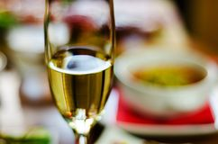 Champagne with set appetizers in small portions, healthy and delicious snacks, tasty set stock image