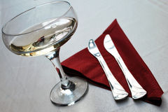 Champagne and silverware Stock Photography