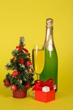 Champagne, small fir-tree in a pot with toys and Stock Photography