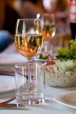 Champagne and snacks. Served with snacks and champagne table Royalty Free Stock Photo