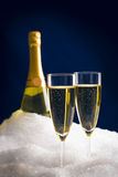 Champagne in snow Royalty Free Stock Photography