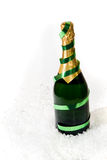 Champagne in the snow. A champagne bottle being chilled in the snow Stock Photography