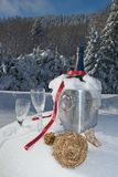 Champagne in snow. Glasses and bottle of champagne in snow Stock Images