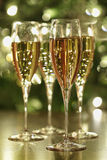 Champagne sparkle. Glasses of champagne sparkle with festive background Royalty Free Stock Photos