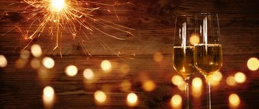 Champagne and sparkler in front of a wooden wall. With bokeh for a new year celebration Royalty Free Stock Images