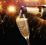 Champagne with sparklers. Happy new year, champagne with sparklers on dark background Royalty Free Stock Photos