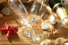 Champagne sparkling on a beach Royalty Free Stock Photos