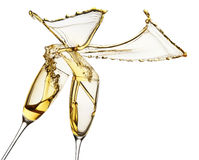 Champagne splashes from glasses isolated on the white background Stock Photos