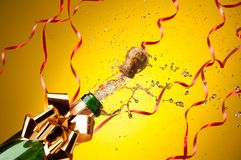 Champagne splashes from just opened bottle Royalty Free Stock Photography